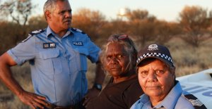photo (L-R) Warakurna's Senior Sargeant Revis Ryder, Ngaanyatjarra elder Daisy Ward and Sargeant Wendy Kelly.